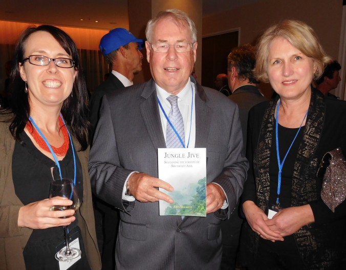 Dr Lyndall Bull, director, Forestry Tasmania, and Cr Christine Sindt, Latrobe City, Victoria, congratulate John Halkett at the book launch at the Melbourne Outlook and Insights Conference.