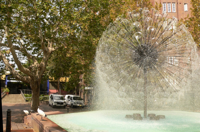 El-Alamein Memorial Fountain and plane trees.